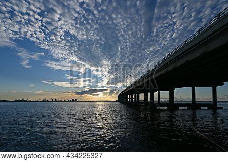 Rickenbacker Causeway Bridge In Miami, Florida Under Dramatic Summer Cloudscape At Sunrise.