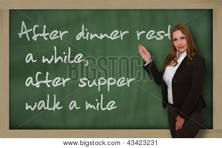 Teacher Showing After Dinner Rest A While, After Supper Walk A Mile On Blackboard