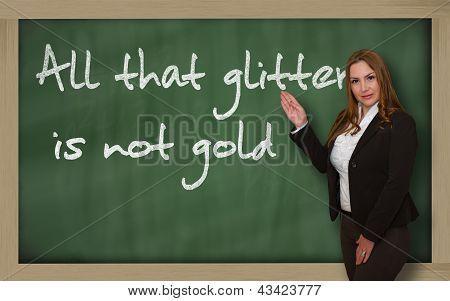 Teacher Showing All That Glitters Is Not Gold On Blackboard