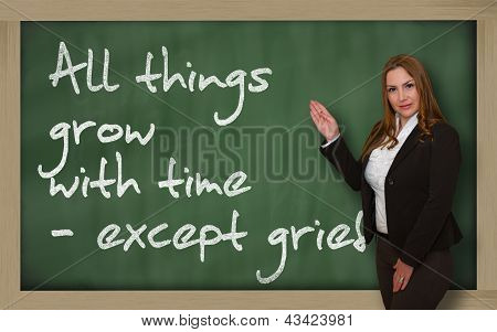 Teacher Showing All Things Grow With Time - Except Grief On Blackboard