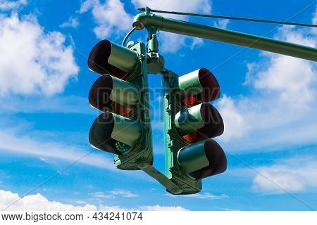 Green Traffic Light On Green Against Clear Blue Sky In New York City, Ny, Usa