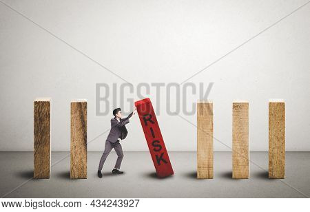 Risk Of Investment With Economy, Businessman Push And Stop Wooden Block Domino With Falling, Managem