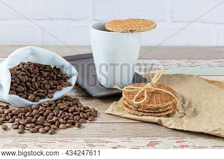 Stroopwafel Cookies With A Sisal Bow Next To A Cup Of Coffee.