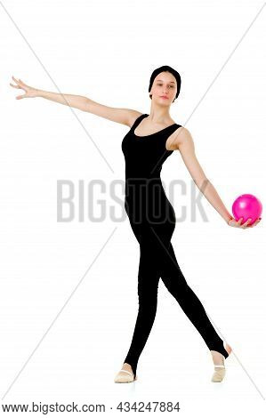 Girl In Sports Outfit Doing Gymnastics With Ball. Full Length Portrait Of Graceful Teenage Girl Gymn