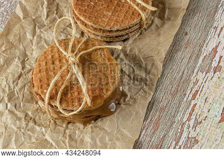 Stacking Pairs Of Stroopwafel On A Brown Paper (copy Space).