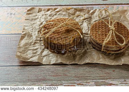 Stacking Pairs Of Stroopwafel On A Brown Paper.