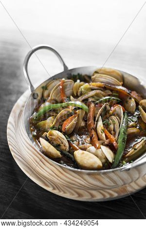 Spanish Mediterranean Clam And Vegetable Stew In Pot At Barcelona Restaurant
