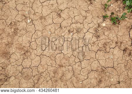 Dry Cracked Soil During A Drought In The End Of May