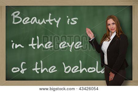 Teacher Showing Beauty Is In The Eye Of The Beholder On Blackboard
