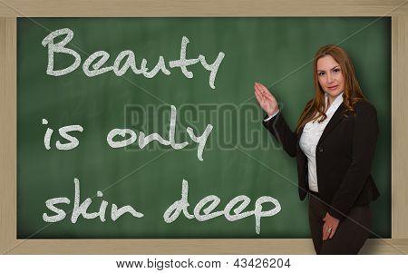 Teacher Showing Beauty Is Only Skin Deep On Blackboard