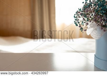 Beautiful Bouquet With Fresh Flowers On Table In Bedroom. Space For Text. Vase With Beautiful Small