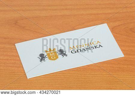 Pruszcz Gdanski, Poland - July 8, 2021: Business Card With The Logo Of Mennica Gdanska.