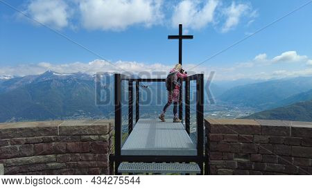 Backpacker Photographer Woman Taking Pictures With Camera On Tamaro Mount Cross Platform In Switzerl