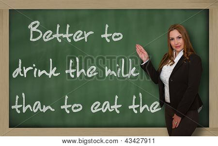 Teacher Showing Better To Drink The Milk Than To Eat The Cow On Blackboard