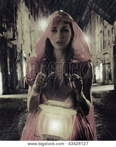 Mysterious photo of a woman with lamp