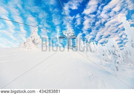 Majestic winter landscape of ski slopes and ski lifts in Lapland Finland