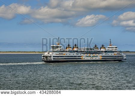Texel, The Netherlands. September 2021. A Passing Ferry On Its Way To The Island Of Texel.