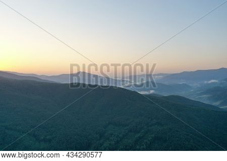 Peaks Of The Carpathian Mountains At Sunset. Sunset In The Mountains, Top View. Forest And Mountains