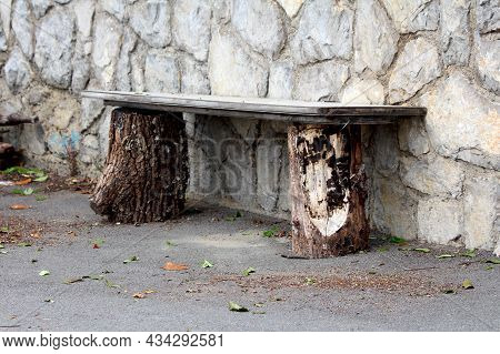 Makeshift Homemade Old Wooden Bench Made From Two Dilapidated Wooden Boards On Top Of Two Wooden Log