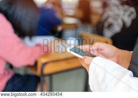 Professor Or Teacher Female Asian With Mask Prevent Covid-19, Teacher Teaching Or Speaking Using Sma