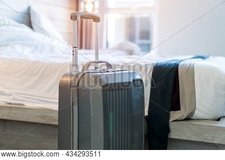 Traveler Suitcase In Bedroom For Enjoyable Trip Ready For Travel. Preparation In Baggage Journey Hol