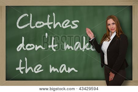 Teacher Showing Clothes Don't Make The Man On Blackboard