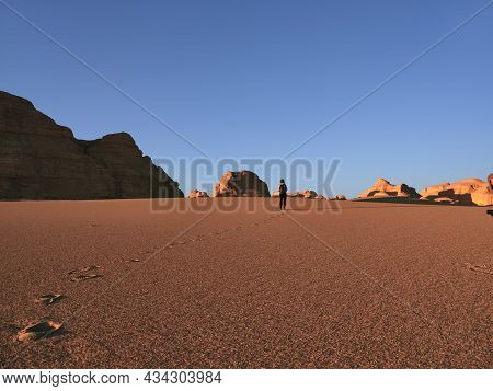 Rear View Of Asian Woman Female Tourist Walking In National Geological Park Near Dunhuang, Gansu Pro