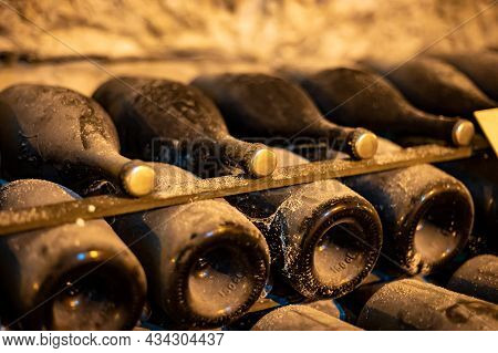 Visit Of Deep And Long Undergrounds Caves For Making Champagne Sparkling Wine From Chardonnay And Pi