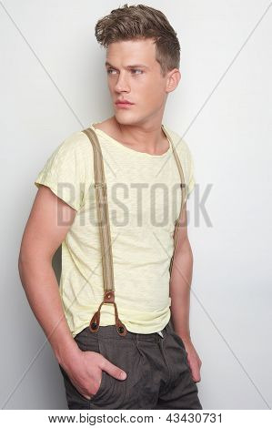 Handsome Man Leaning Against Wall