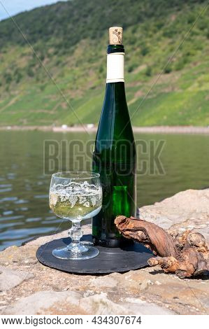 Tasting Of White Quality Riesling Wine With View On Steep Slopes Of Vineyards Overlooking Mosel Rive