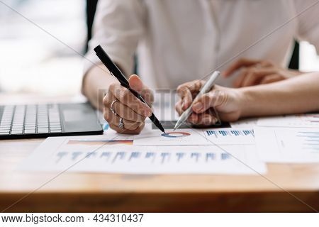 Business People Planning Strategy Analysis From Financial Document Report, Office Concept.