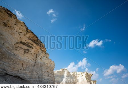 Cliff Swallow Mud Homes Built Into The Cliff Face Of Monument Rocks In Rural Kansas, Usa