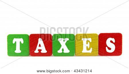 Taxes - Isolated Text In Wooden Building Blocks