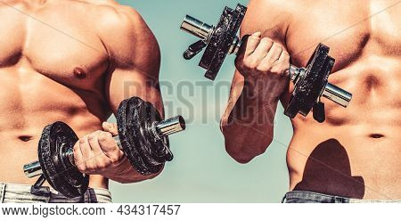 Strong Bodybuilder, Perfect Deltoid Muscles, Shoulders, Biceps, Triceps And Chest. Dumbbell. Muscula