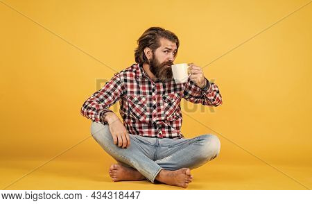 Just One Sip. Lifestyle Concept. Handsome Hipster Man With Cup Of Coffee. He Is Taking A Coffee Brea