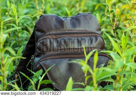 Multifunctional Or Laptop Carrying Leather Travel Bag Into The Wild Green Grass