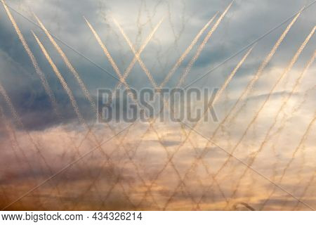 Flying Fireworks In The Night Sky. Line Trackrs Create A Pattern Of A Cage. Head Of The Comet And It