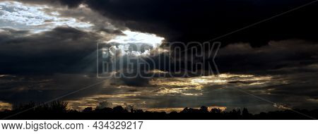 Dramatic View Of The Sky And Clouds Over The Landscape At Sunset.
