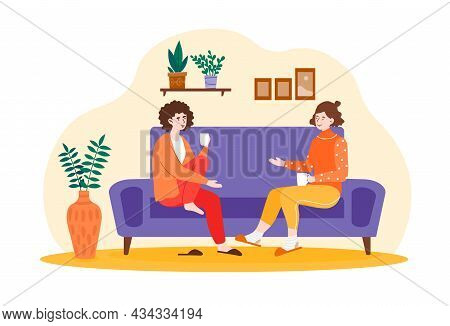 Smiling Female Friends Are Drinking Tea At Home Together. Happy Female Laughing And Gossiping On Com