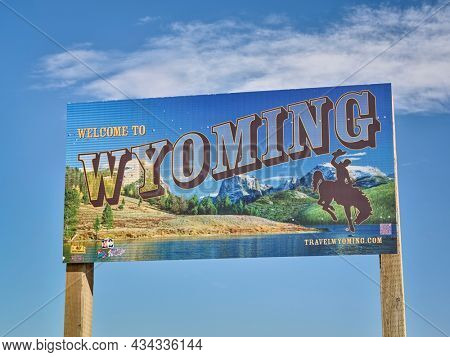 Cheyenne, WY, USA - April 2, 2021: Welcome to Wyoming - road sign with some stickers added by travelers