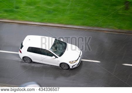 Ostrava, Czech Republic - May 13, 2021: White Volkswagen Golf Car In A Strong Thunderstorm With A He