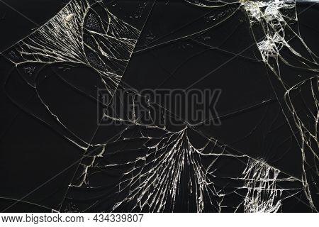 Broken Glass Smartphone Screen Texture With Cracks. Black Cracked Phone Display.