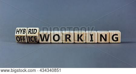 Hybrid Or Office Working Symbol. Turned Wooden Cubes And Changed Words 'office Working' To 'hybrid W