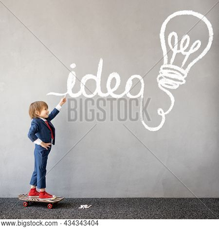 Funny Kid Pretend To Be Businessman. Child Draws Chalk Graph On The Wall. Business Startup And Devel