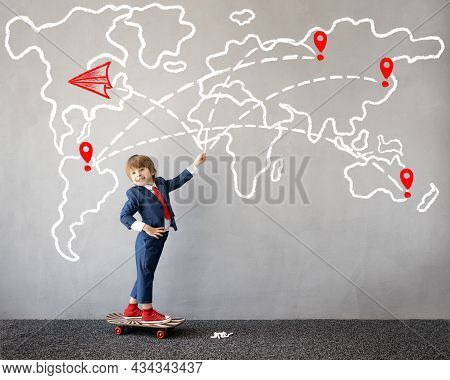 Funny Kid Pretend To Be Businessman. Child Draws Chalk World Map On The Wall. Business Startup And D