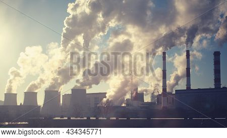 Smoke From Industrial Pipes On A Clear Sunny Day, Smog From Factory Waste