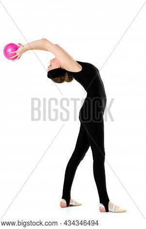Flexible Slim Girl Doing Exercise With A Ball. Full Length Portrait Of Graceful Slim Teenage Girl In