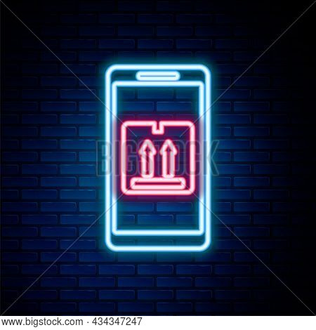 Glowing Neon Line Mobile Smart Phone With App Delivery Tracking Icon Isolated On Brick Wall Backgrou
