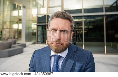 Confused Face Of Entrepreneur In Businesslike Suit Outside The Office, Sadness
