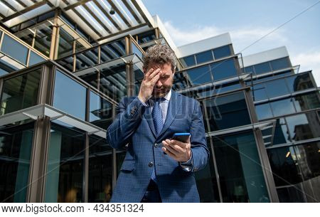 Bankruptcy Of Sad Mature Business Man In Formalwear Holding Phone Outdoor, Anxiety
